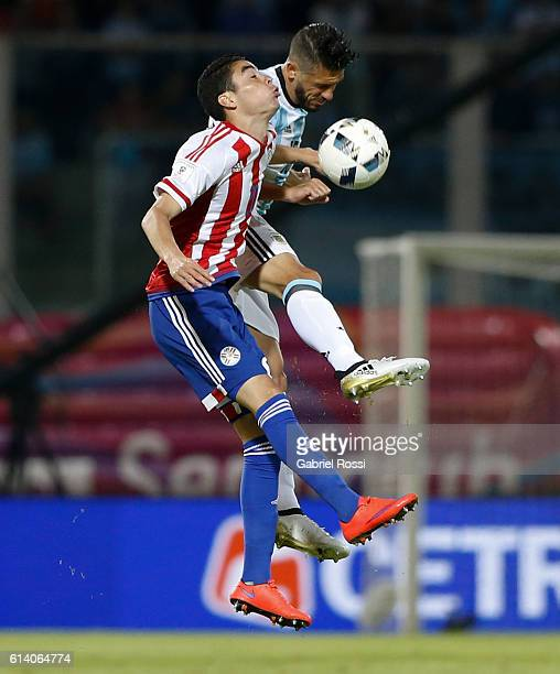 Martin Demichelis of Argentina jumps for the ball with Miguel Almiron of Paraguay during a match between Argentina and Paraguay as part of FIFA 2018...