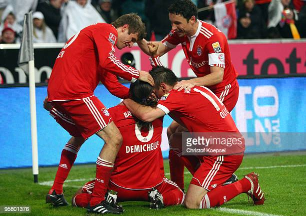 Martin Demichelis of Bayern celebrates the first goal with Holger Badstuber Ivica Olic and Mark van Bommel a goal during the Bundesliga match between...