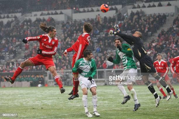 Martin Demichelis of Bayern does a header against Marco Caligiuri Marino Biliskov and Stephan Loboué during the DFB Cup quarter final match between...