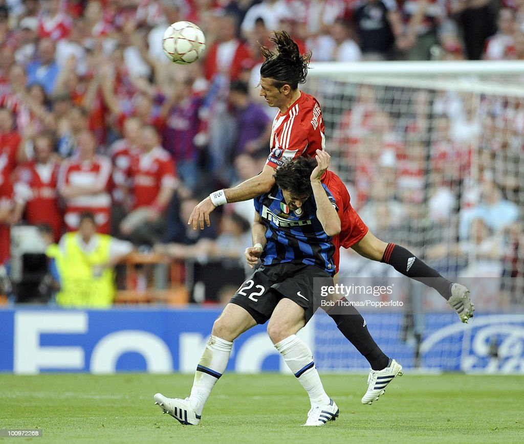 Martin Demichelis of Bayern Munich heads the ball away from Diego Milito of Inter Milan during the UEFA Champions League Final match between Bayern Munich and Inter Milan at the Estadio Santiago Bernabeu on May 22, 2010 in Madrid, Spain.