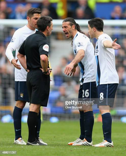 Martin Demichelis of Manchester City and his teammates protest to Referee Lee Probert during the Barclays Premier League match between Everton and...