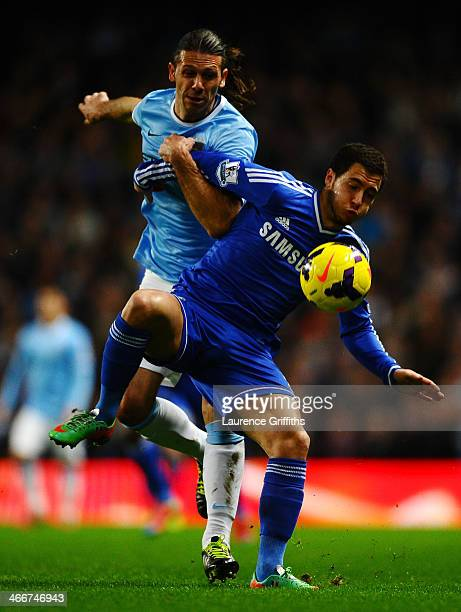 Martin Demichelis of Manchester City battles with Eden Hazard of Chelsea for the ball during the Barclays Premier League match between Manchester...