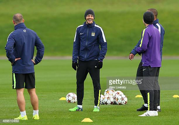 Martin Demichelis of Manchester City laughs during a training session at the Manchester City Football Academy on November 24 2014 in Manchester...
