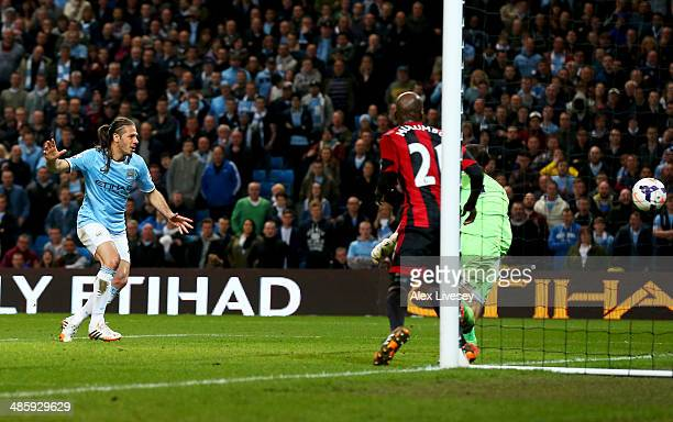 Martin Demichelis of Manchester City scores their third goal past goalkeeper Ben Forster of West Bromwich Albion during the Barclays Premier League...