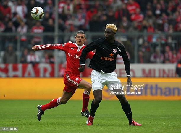 Martin Demichelis of Muenchen battles for the ball with Aristide Bance of Mainz during the Bundesliga match between FC Bayern Muenchen and FSV Mainz...