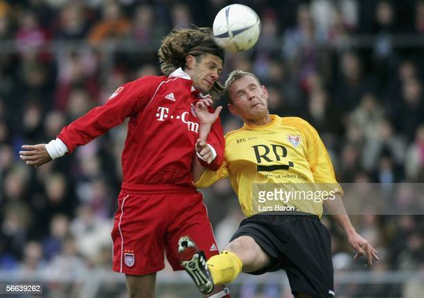 Martin Demichelis of Munich goes up for a header with Stephan Heller of Uerdingen during the friendly match between KFC Uerdingen and Bayern Munich...