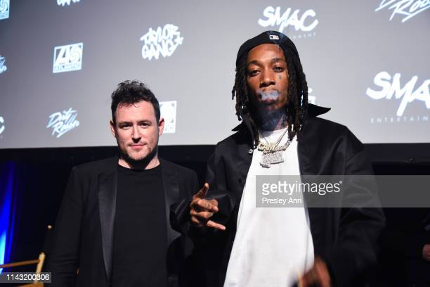 Martin Desmond Roe and Wiz Khalifa attend Apple Music Wiz Khalifa Behind The Cam Premiere on April 16 2019 in Inglewood California