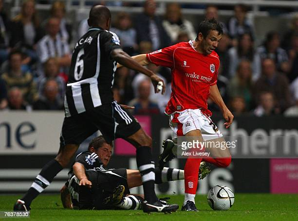 AUGUST 29 Martin Devaney of Barnsley beats a challenge from Emre Belozoglu of Newcastle United during the Carling Cup second round match between...