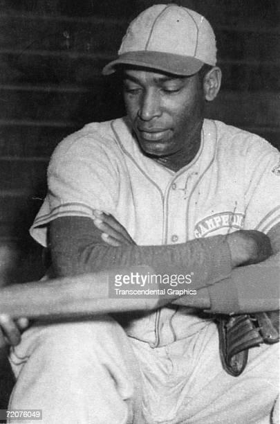 Martin Dihigo discusses batting before a game in the Venezuelan League in 1941.