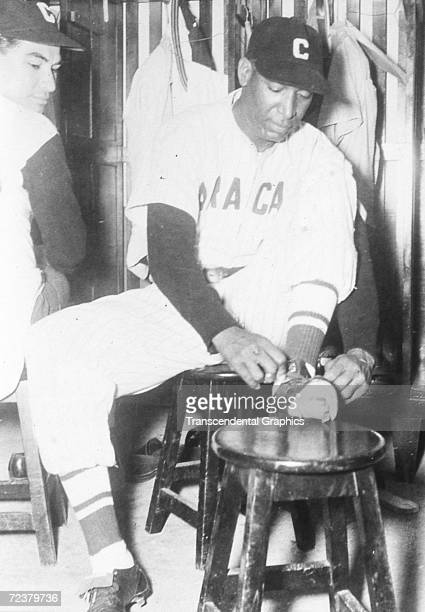 Martin Dihigo, pitcher and outfielder for the Caracas team in the Venezuelan league, dresses for an upcoming game in Caracas in 1933.