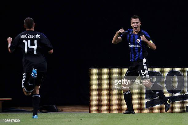 Martin Dobrotka of Bratislava celebrates his team's first goal with team mate Michal Breznanik during the UEFA Europa League playoff second leg match...