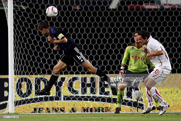 Martin Dobrotka of Bratislava scores his team's first goal against goalkeeper Sven Ulreich and Christian Gentner of Stuttgart during the UEFA Europa...