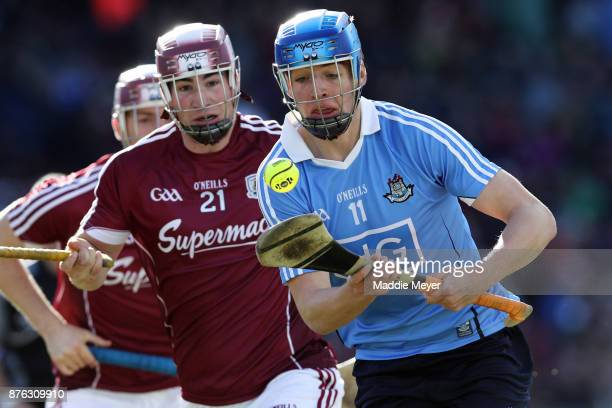 Martin Dolphin defends Chris Crummy in the match between Dublin and Galway during the 2017 AIG Fenway Hurling Classic and Irish Festival at Fenway...