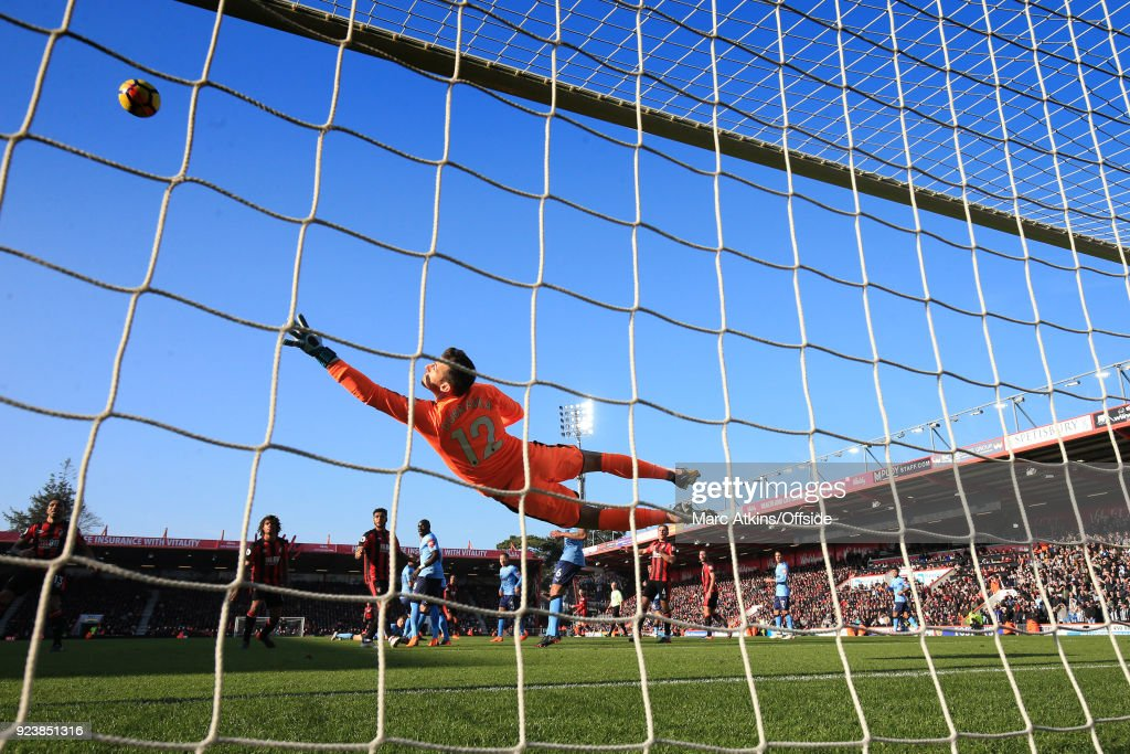 Martin Dubravka of Newcastle dives to make a save during the Premier League match between AFC Bournemouth and Newcastle United at Vitality Stadium on February 24, 2018 in Bournemouth, England.
