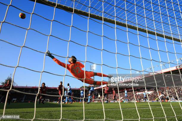 Martin Dubravka of Newcastle dives to make a save during the Premier League match between AFC Bournemouth and Newcastle United at Vitality Stadium on...