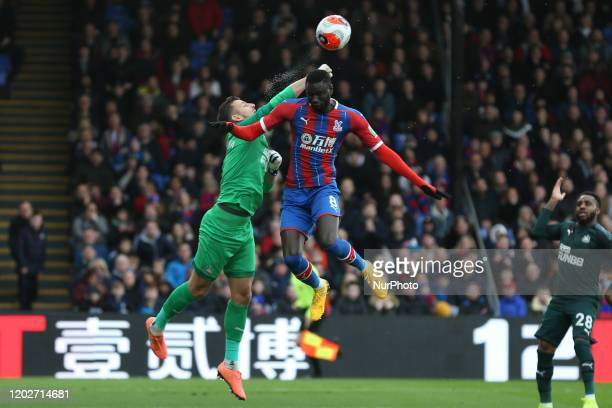 Martin Dubravka of Newcastle United and Christian Benteke of Crystal Palace jumping for the ball during the Premier League match between Crystal...