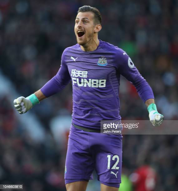 Martin Dubravka of Newcastle United celebrates Kenedy scoring their first goal during the Premier League match between Manchester United and...