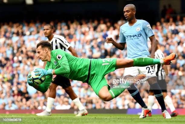 Martin Dubravka of Newcastle United makes a save during the Premier League match between Manchester City and Newcastle United at Etihad Stadium on...