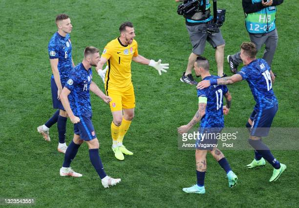Martin Dubravka of Slovakia celebrates with Milan Skriniar and team mates after victory in the UEFA Euro 2020 Championship Group E match between...