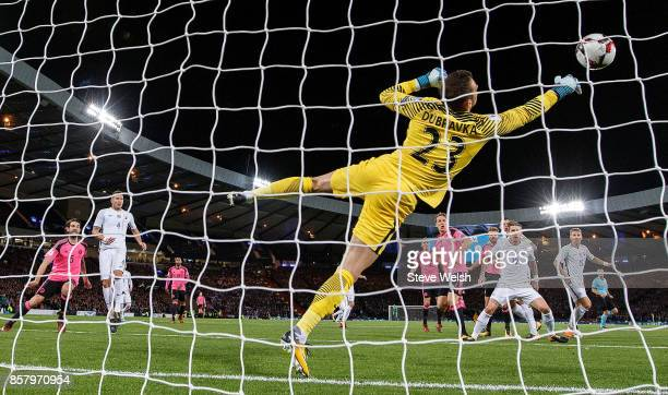 Martin Dubravka of Slovakia makes as save during the FIFA 2018 World Cup Group F Qualifier between Scotland and Slovakia at Hampden Park on October 5...