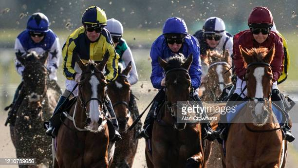 Martin Dwyer riding Lake Lucerne on their way to winning The Good Friday Spring Country Fair Maiden Fillies' Stakes at Chelmsford City Racecourse on...