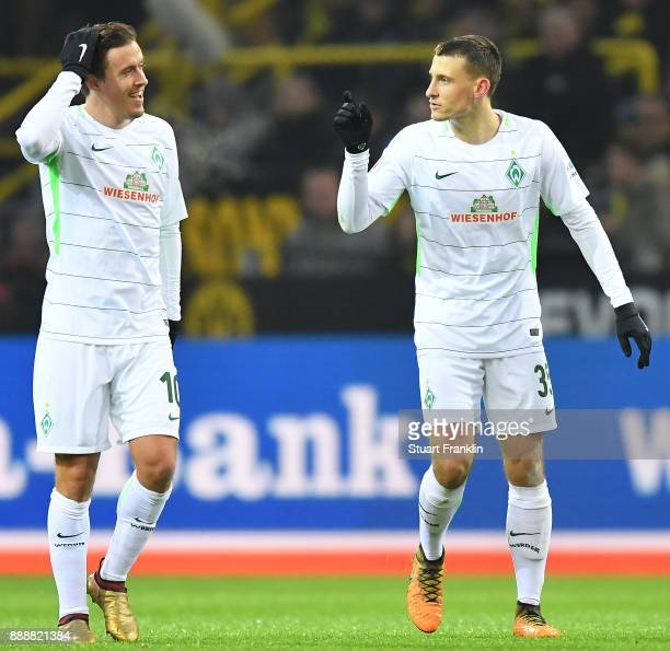 Martin Eggestein of Bremen celebrates with Max Kruse of Bremen after he scored a goal to make it 10 during the Bundesliga match between Borussia...