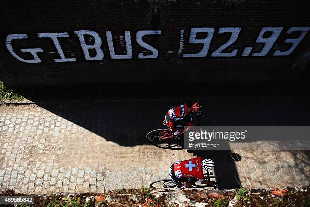 Martin Elmiger of Switzerland and IAM Cycling and Rick Zabel of Germany and the BMC Racing Team in action during the 2015 Paris Roubaix cycle race...