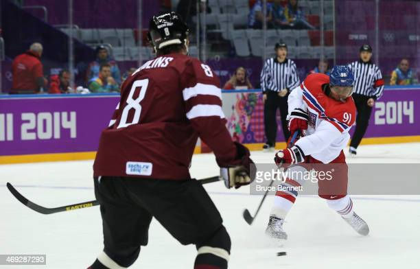 Martin Erat of Czech Republic shoots and scores against Sandis Ozolins of Latvia in the first period during the Men's Ice Hockey Preliminary Round...