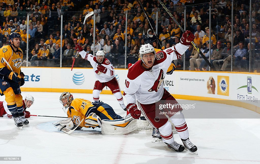 Martin Erat #10 of the Arizona Coyotes celebrates his goal against goalie Pekka Rinne #35 of the Nashville Predators at Bridgestone Arena on October 21, 2014 in Nashville, Tennessee.
