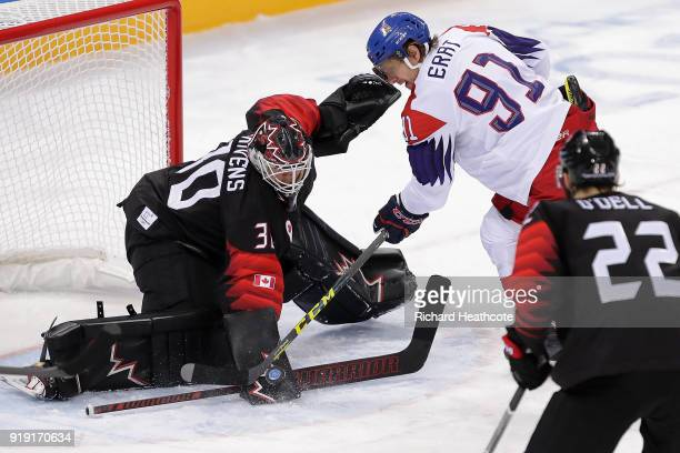 Martin Erat of the Czech Republic attempts a shot on Ben Scrivens of Canada during the Men's Ice Hockey Preliminary Round Group A game on day eight...