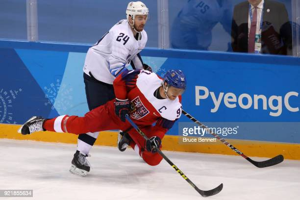 Martin Erat of the Czech Republic collides with Jonathon Blum of the United States in the third period during the Men's Playoffs Quarterfinals on day...