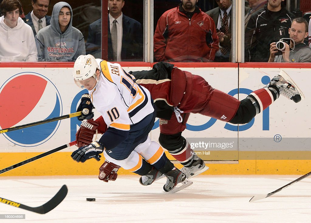 Martin Erat #10 of the Nashville Predators is knocked off the puck by a Phoenix Coyote defender at Jobing.com Arena on January 28, 2013 in Glendale, Arizona.