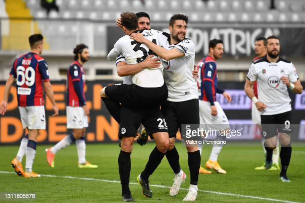 Martin Erlic of Spezia celebrates with teammates Ardian Ismajli and Riccardo Marchizza after scoring their team's third goal during the Serie A match...