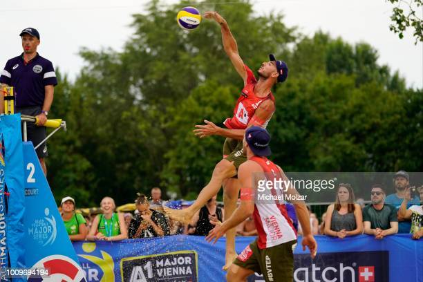 Martin Ermacora of Austria smashes the ball during the pool match between Martin Ermarcora and Moritz Pistrauz of Austria and Viacheslav Krasilnikov...