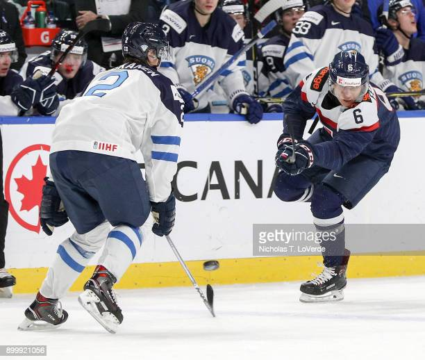 Martin Fehérváry of Slovakia shoots the puck past Miro Heiskanen of Finland during the third period of play in the IIHF World Junior Championships at...