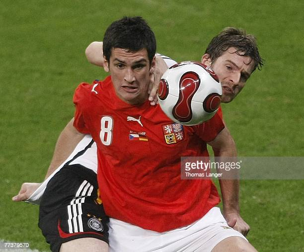 Martin Fenin of Czech Republic and Arne Friedrich of Germany battle for the ball during during the UEFA Euro2008 Group D qualifying match between the...