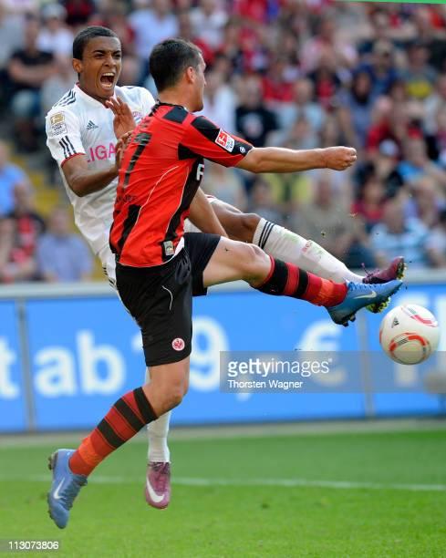 Martin Fenin of Frankfurt battles for the ball with Luiz Gustavo of Muenchen during the Bundesliga match between Eintracht Frankfurt and FC Bayern...