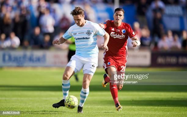 Martin Fisch of FC Helsingor and Pieros Sotiriou of FC Copenhagen compete for the ball during the Danish Alka Superliga match between FC Helsingor...