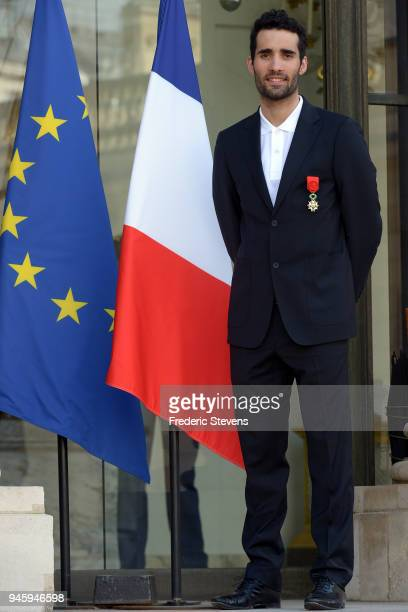 Martin Fourcade biathlon Gold medalist at the Pyeongchang Winter Olympics poses at the Elysee Palace after a cocktail reception hosted by French...