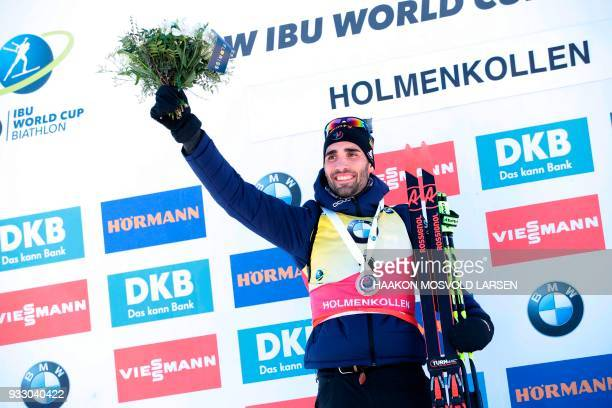 Martin Fourcade from France celebrates on the podium after winning the IBU Biathlon World Cup Men 125 km Pursuit Competition in Holmenkollen Oslo...