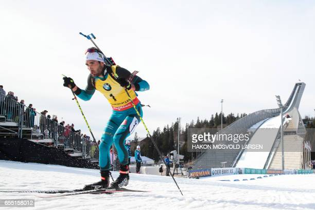 Martin Fourcade from France competes during the IBU Biathlon World Cup Men 15 km Mass Start competition in Oslo on March 19 2017 / AFP PHOTO / NTB...