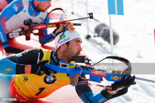 Martin Fourcade from France competes in IBU Biathlon World Cup Men 15 km Mass Start competition in Oslo on March 19 2017 / AFP PHOTO / NTB Scanpix /...
