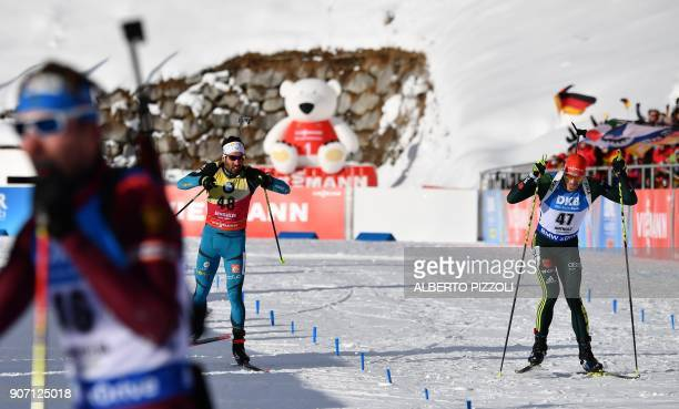 Martin Fourcade of France and Arnd Peiffer of Germany sprint to the finish line during the Men's 10km sprint competition of the IBU World Cup...