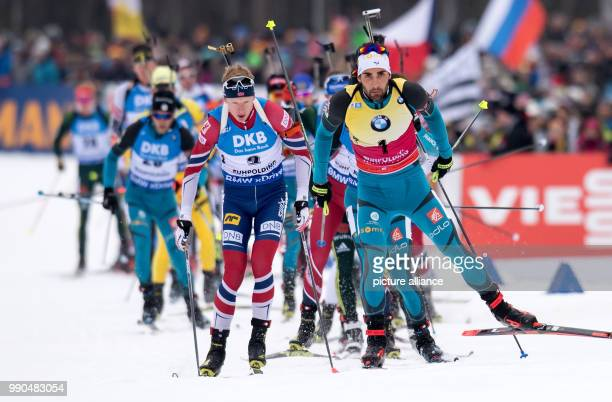 Martin Fourcade of France and Johannes Thingnes Boe of Norway arrive at the shooting range during the men's mass start event of the Biathlon World...