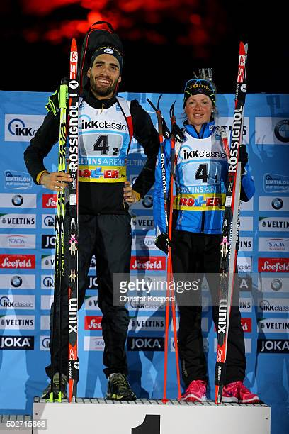 Martin Fourcade of France and Marie Dorin-Habert of France celebrate their victory on the podium during the IKK classic Biathlon World Team Challenge...