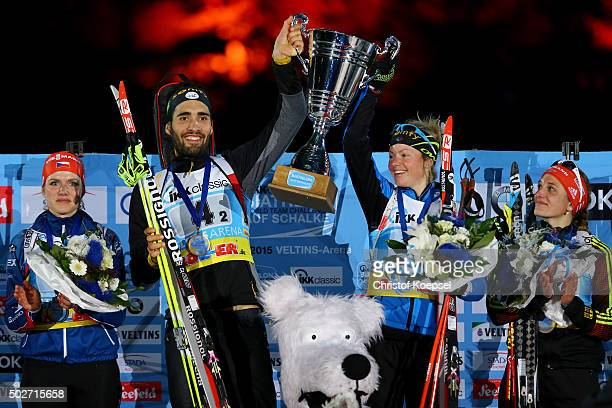 Martin Fourcade of France and Marie Dorin-Habert of France lift the winning trophy on the podium during the IKK classic Biathlon World Team Challenge...