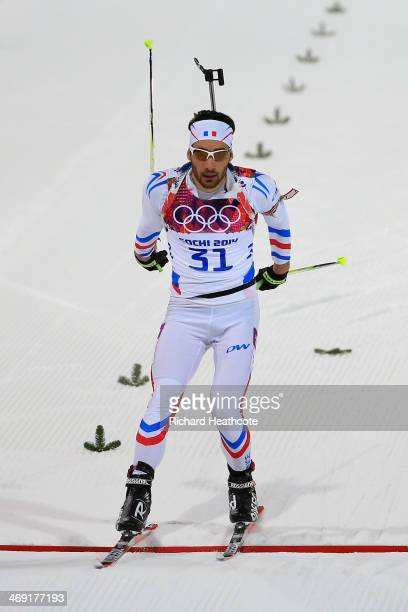 Martin Fourcade of France approaches the finish line in the Men's Individual 20 km during day six of the Sochi 2014 Winter Olympics at Laura...