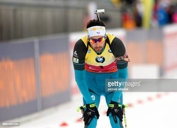 Martin Fourcade of France arrives at the finish of the men's mass start event of the Biathlon World Cup at the Chiemgau Arena in Ruhpolding Germany...
