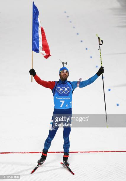 Martin Fourcade of France celebrates after crossing the finish line to win the gold medal during the Biathlon 2x6km Women 2x75km Men Mixed Relay on...