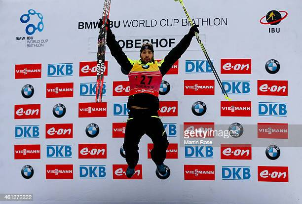 Martin Fourcade of France celebrates after winning the Men's 10 km sprint of the BMW World Cup on January 10, 2015 in Oberhof, Germany.